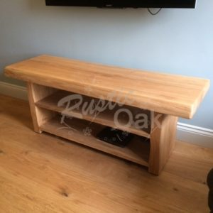 Waney edge Tv unit in an oil finish
